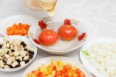 Pouring boiling water to red tomatoes Royalty Free Stock Image
