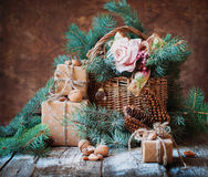 Still Life with Presents in Vintage Style. Boxes Decorated, Basket, Fir Tree, Toys, Walnuts, Almonds Stock Image