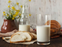 Still life with products. Still life with sliced bread and chilled milk Royalty Free Stock Photos