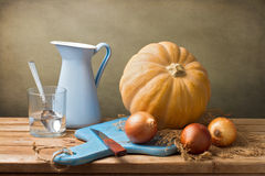 Still life with pumpkin and blue jug Royalty Free Stock Photos