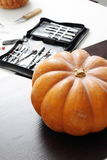 Still life with pumpkin and carving tools Royalty Free Stock Photography