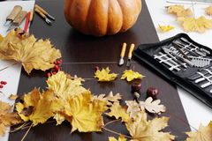 Still life with pumpkin and carving tools Stock Photography