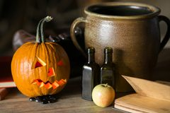 Still life with pumpkin face on halloween in october royalty free stock photo
