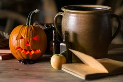 Still life with pumpkin face on halloween in october royalty free stock photos