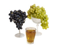 Still life with pumpkin juice. Still life with white grapes, a vase and a glass of grape juice Royalty Free Stock Photos