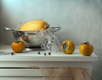 Still life with pumpkin and persimmon Stock Photography