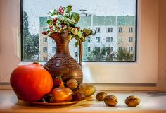 Still life with a pumpkin and a pitcher stock photo