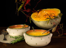 Still life with pumpkin,pumpkin soup and berries Stock Images