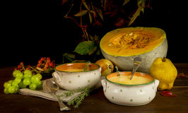 Still life with pumpkin,pumpkin soup and berries Royalty Free Stock Image