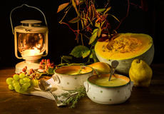 Still life with pumpkin,pumpkin soup and berries Stock Photos