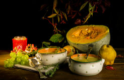 Still life with pumpkin,pumpkin soup and berries Royalty Free Stock Photography