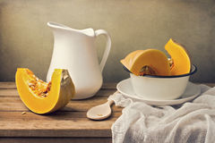Still life with pumpkin and white jug Royalty Free Stock Photography