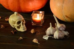 Still life with pumpkins and skull Stock Image