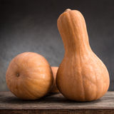 Still life of pumpkins. On a wooden board Stock Images
