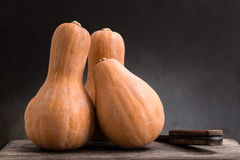 Still life of pumpkins. On a wooden board Royalty Free Stock Photos