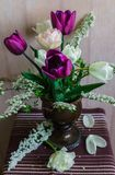 Still life of purple and pale pink tulips royalty free stock photo
