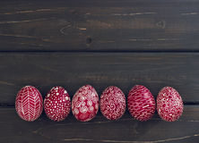 Still life with Pysanka, decorated Easter eggs, on black wooden Stock Photography