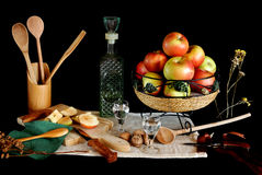 Still life with rakia and apples. Still-life with rakia and apples. Rakia is an alcoholic drink that is produced by distillation of fermented fruit. Rakia is Stock Photography