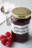 A still life of raspberry jam in jar Stock Photography