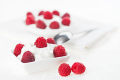 Still life with raspberry sour cream dessert. On white linen table cloth, copy space design ready Royalty Free Stock Photography