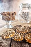 Still life recipe homemade honey ginger oatmeal cookie, pirouette rolled wafer and grain stick on wooden table kitchen Royalty Free Stock Photos