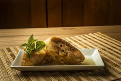 French toast in a rectangular dish on a bamboo mat Stock Image