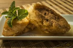 French toast in a rectangular dish on a bamboo mat Royalty Free Stock Images