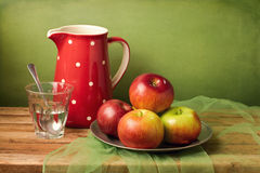 Still life with red apples and jug Royalty Free Stock Image