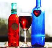 Still Life Red Blue Wine Glass Bottles & Heart & Pottery Charms Stock Images