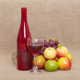 Still-life - red bottle of wine and fruit Royalty Free Stock Photography