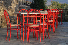 Still life with red chairs and tables. Lesbos, Greece Stock Photo