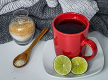 Still life with red Cup flowers and lemon Stock Photo