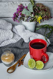 Still life with red Cup flowers and lemon Royalty Free Stock Photos
