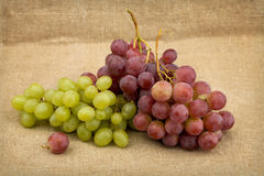Still life with red and green ripe grapes Stock Images