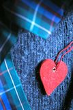 Still life with red heart. On coarse-meshed stuff and band royalty free stock photography