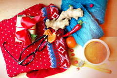 Still life with red knitted sweater, socks, sunglasses and coffee Royalty Free Stock Image