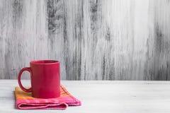 Still life red mug kitchen cloth Stock Photography