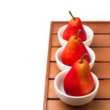 Still life with red pears and white bowls Royalty Free Stock Image