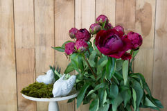 Still life of red peony flowers on wooden background Stock Photo