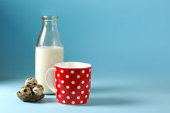Still life with red, in polka dot, cup of milk, quail eggs and vintage glass bottle Stock Images