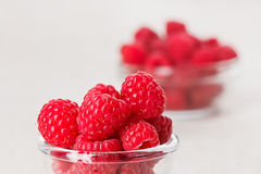 Still life with red raspberry and glass bowl Royalty Free Stock Photo
