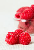 Still life with red raspberry and glass bowl on gray linen Stock Photo