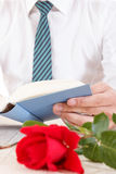 Still life with red rose and old book Royalty Free Stock Images