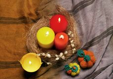 Still life with red and. Yellow candles, and knitted pumpkins Royalty Free Stock Photography