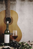 Still life of red wine bottle and wine glass Royalty Free Stock Images