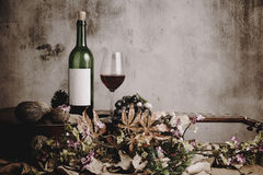 Still life of red wine bottle and wine glass Stock Photos