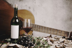 Still life of red wine bottle and wine glass Stock Photography