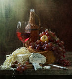 Still-life with red wine and cheese and fruit. Wine with cheese and fruit royalty free stock image