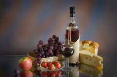 Still life with red wine, cheese and fruit royalty free stock photography