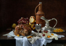 Still-life with red wine, fruit and a hen a grill. Wine, fruit, a hen a grill and a beautiful jug stock image